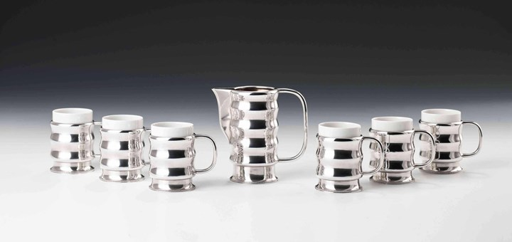 SILVER MILK JUG WITH SIX CUPS